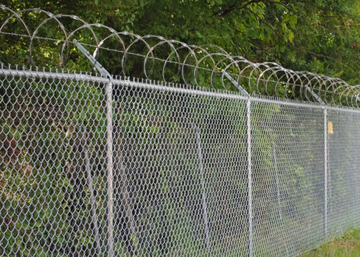 Chain Link Fence Top With Barbed Wire Or Razor Wire In